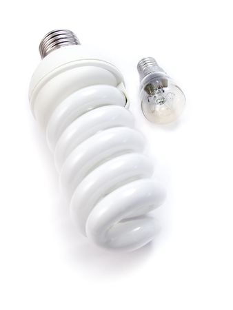 An energy efficient bulb and a small electric bulb. Isolated on a white background
