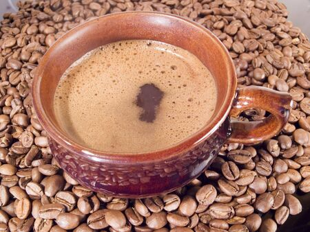 Cup with hot coffee and coffee grains Stockfoto