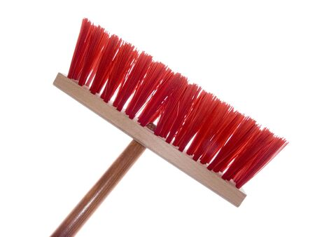 Wooden red brush for cleaning a floor isolated on a white background Stockfoto