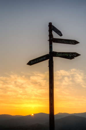 where to go: sunrise with sign - contrast Stock Photo