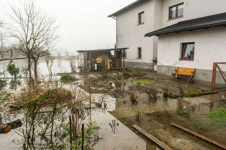 House with its gardens flooded after spring thaw photo