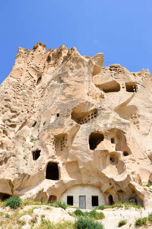 Building cut into stone formation, Cappadocia, Central Turkey Stock Photo