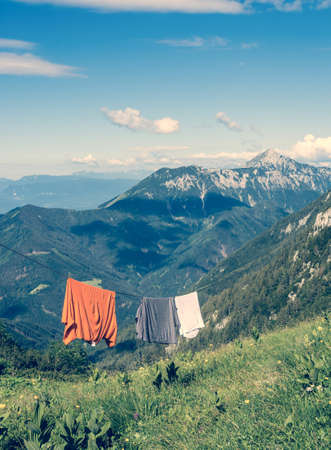 Laundry driying on a rope with mountain view photo