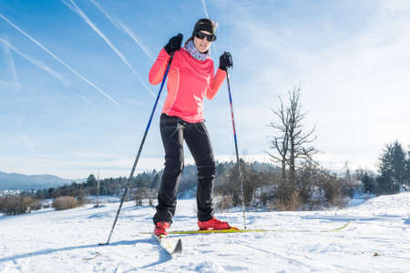 skiing: Woman cross country skiing on a yellow skis Stock Photo