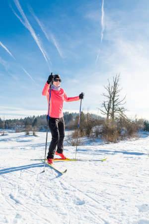 Woman cross country skiing on a yellow skis Stock Photo
