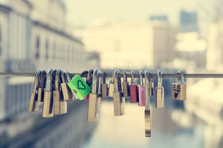 lock symbol: Green love lock over the river Stock Photo
