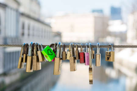 Green love lock over the river Stock Photo