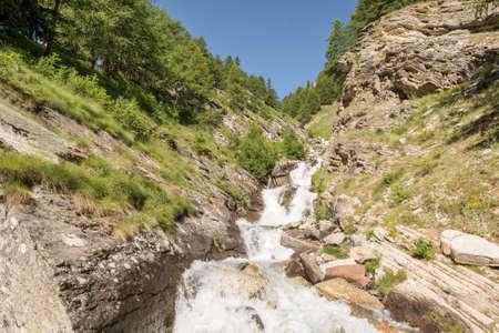 independance: Water for alpine glacier flowing through a rocky stream.