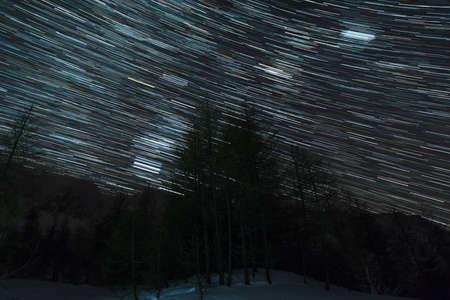 karavanke: Star trails above alpine forest. Zelenica, Slovenia. Stock Photo
