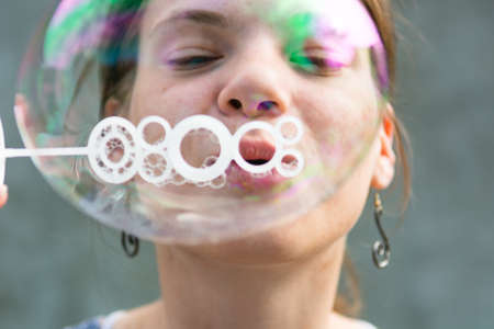 preety: Young girl having fun and blowing bubbles.