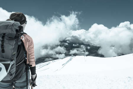 crampons: Female alpinist enjoying a mountain view. Close up of mountaineer.