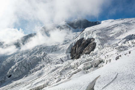massif: Glacier. Mountain panorama with snow and ice covering slope. Monte Rosa massif.