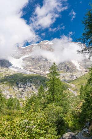 circling: Mountain peak. Clouds circling around Monte Rosa massif. Stock Photo