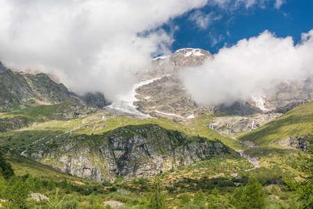massif: Mountain peak. Clouds circling around Monte Rosa massif. Stock Photo