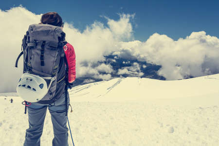 alpinist: Female alpinist enjoying a mountain view. Close up of mountaineer.