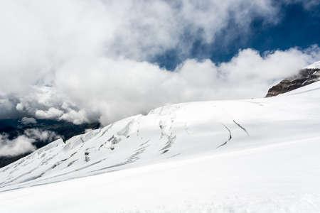 crack climbing: Glacier. Ice cracking on glacier slope at Monte Rosa massif.