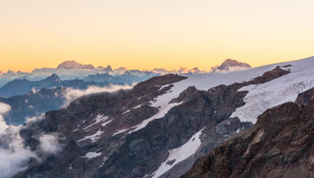 blanc: Alpine sunset. Sun setting behind Mont Blanc. Stock Photo