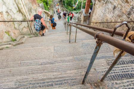 descending: Descending staircase. Closeup of rail leading down.