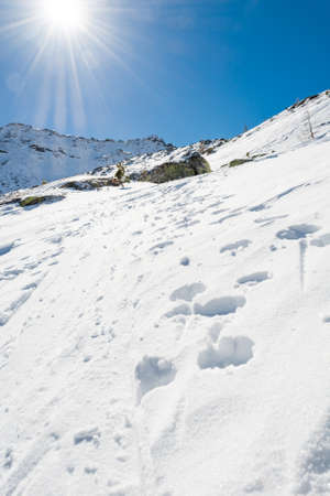 extreme weather: Snow trail ascneding a slope. Maltatal valley in Austria.
