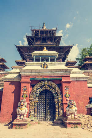 guarded: Temple gate guarded by deities. Entrance to a monastery at Durbar square in Kathmandu.