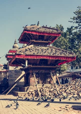 supported: Temple supported by beams. Building damaged by earthquake at Durbar square in Kathmandu.