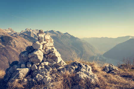 rock pile: Pile of stones. Rock pile on mountain top with blurred background.