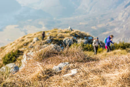 blurred people: People ascending a mountain. Hikers blurred in the background. Stock Photo