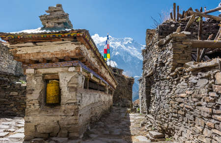 Buddhist praying wheels - Annapurna region. Traditional Nepali village. Banco de Imagens