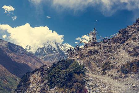 dirt path: Mountain panorama with dirt path. Annapurna circuit in Nepal. Stock Photo
