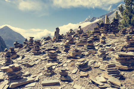 serenety: Stone piles with mountain on background. Annapurna circuit in Nepal. Stock Photo