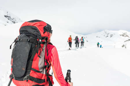 back country: Ski tourer at a group skiers. Winter back country activity.. Stock Photo
