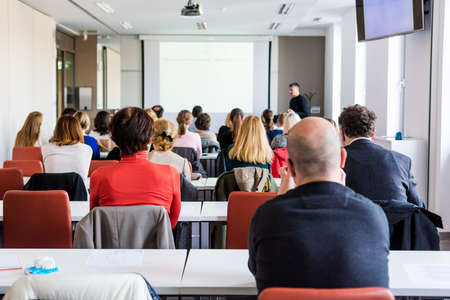 proffesional: Audience at business conference. People listening to lecture. Stock Photo