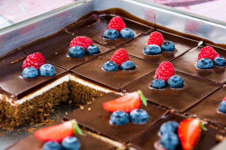 food photography: Tasty chocolate pastry with fresh berries. Street food photography on open kitchen event. Stock Photo