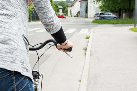 handlebar: Closeup of cyclist holding a handlebar. Woman riding a bicycle. Stock Photo