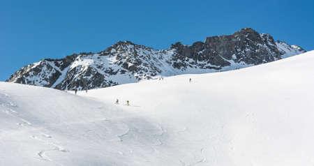 off piste: Snow covered slope with ski tracks. Enjoying off piste skiing.