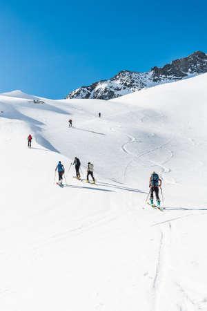 ascending: Skiers ascending a mountain slope. Ski touring in Malta valley, Austria.