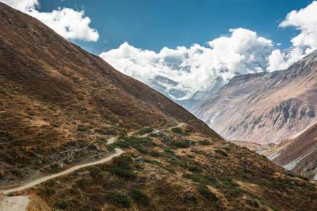 Mountain trail on a steep slope. Trekking is a nice way to enjoy Annapurna region in Nepal.