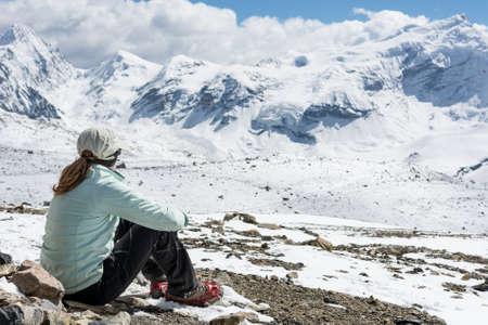 Young woman enjoying the mountain view. No stress environment meditation.