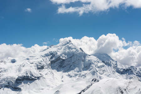 Mountain covered with snow landscape. Thorong La pass trek in Nepal crossing 5416 m.