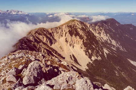 karavanke: Spectacular mountain panorama, mists slowly starting to rise. Stol is the heighest peak of Karavanke in Slovenia.