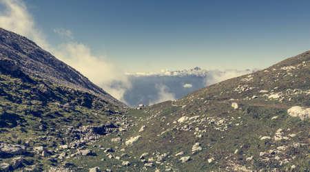 karavanke: Silhouette of a person ascending a green valley. Stol mountain in Slovenia.