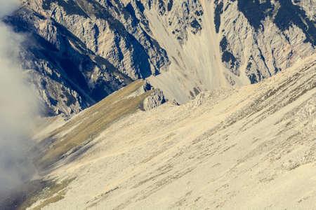 karavanke: Mountain slope finishing with a steep ridge. Ascending Stol, the heighest peak of Karavanke in Slovenia.