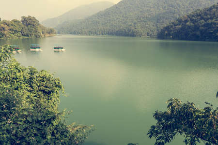 phewa: Lake Phewa surrounded by forest. Stock Photo