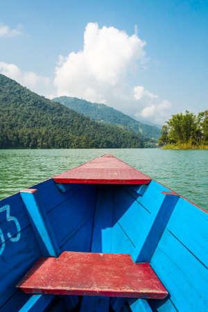 phewa: Boat ride across tropical river. Stock Photo