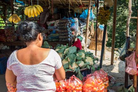 Customer at local vegetable market.
