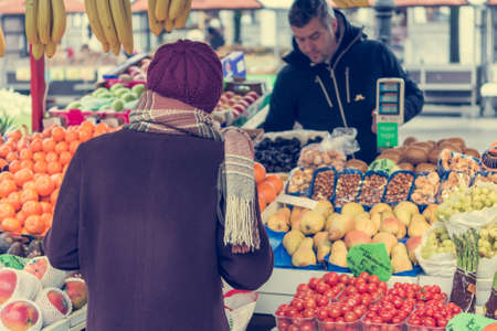 buying: Customer buying fruits. Stock Photo