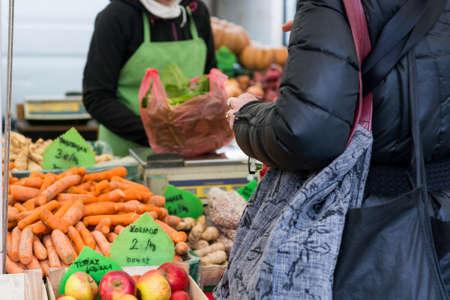 buying: Customer buying healthy vegetables.