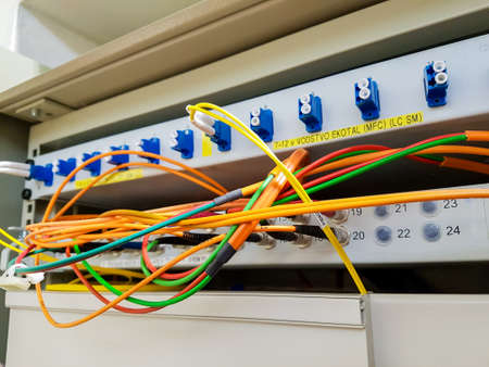 Closeup of fiber optic cable plugged into switch. Stock Photo