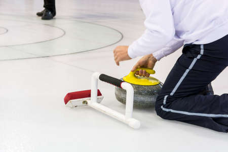 ice sheet: Playing a game of curling.