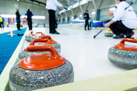 Curling stone on a game sheet. Stock Photo